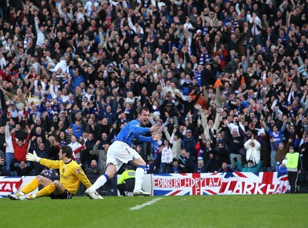 Rangers' Kris Boyd (r) celebrates after equalising for Rangers close to full time