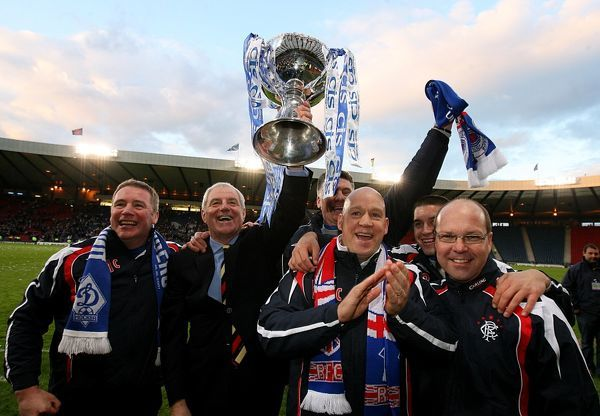 Rangers' First team coach Kenny McDowell (centre, right), assistant manager Ally McCoist (l), manager Walter Smith (2nd l) Head of Sports Science Adam Owen (2nd, r) and Pip Yeates club Physiotherapist (r) celebrate with the CIS
