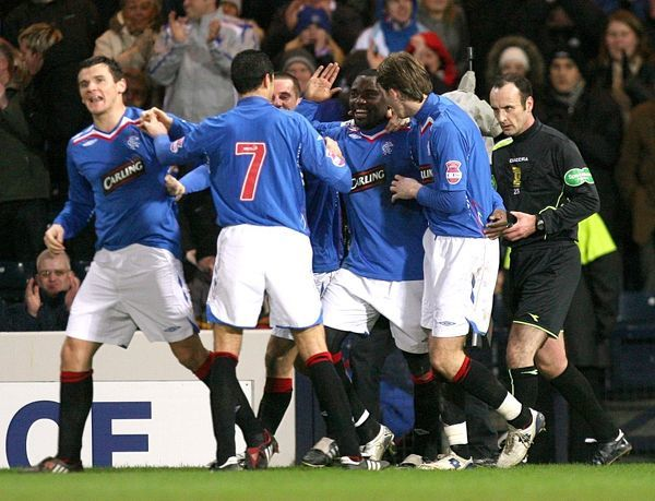 Rangers' Jean Claude Darcheville celebrates after scoring the second goal of the match with team mates