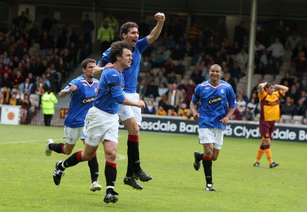 Christian Dailly, rangers celebrates scoring the opening goal