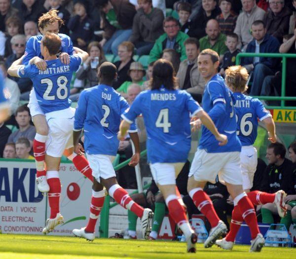 Steven Whittaker, Rangers celebrates with his teammates