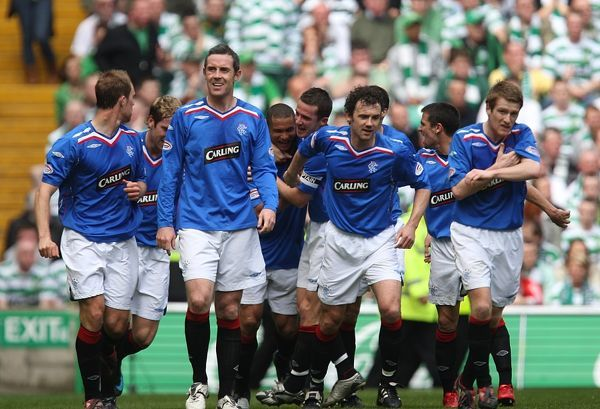 Rangers' Daniel Cousin celebrates scoring his sides second goal of the game with teammates