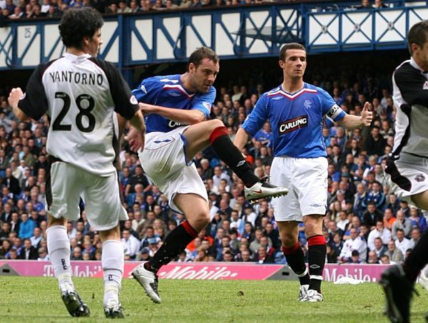 Rangers' Kris Boyd (second left) scores the opening goal of the game