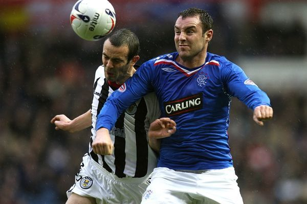 St Mirren's John Potter (l) and Rangers' Kris Boyd battle for the ball