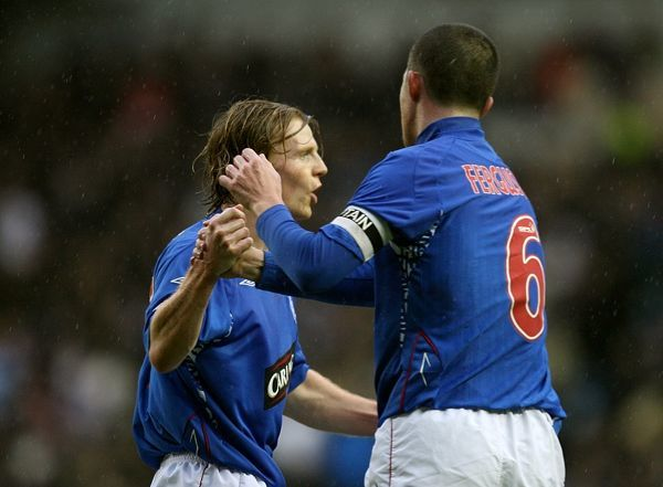 Rangers' Chris Burke (l) celebrates scoring his sides first goal with teammate Bary Ferguson