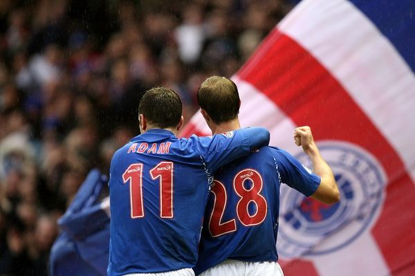 Rangers' Steven Whittaker (r) celebrates scoring his sides third goal with teammate Charlie Adam