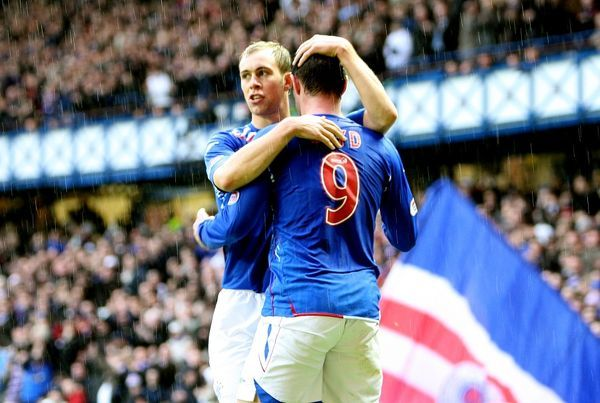 Rangers' Steven Whittaker (l) celebrates scoring his sides fourth goal with teammate Kris Boyd