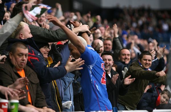 Rangers' Daniel Cousin celebrates with the home fans after opening the scoring