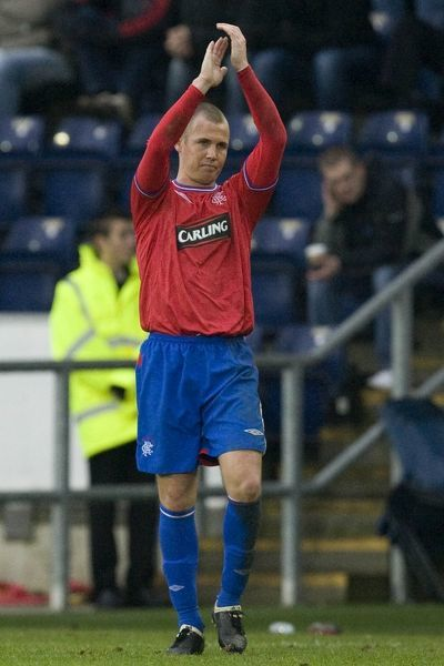Rangers' Kenny Miller applauds his fans after being substituted