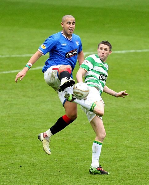 Rangers' Madjid Bougherra (left) and Celtic's Robbie Keane battle for the ball