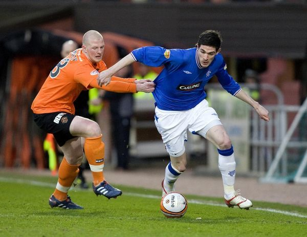 Rangers' Kyle Lafferty skips past Dundee United's Garry Kenneth