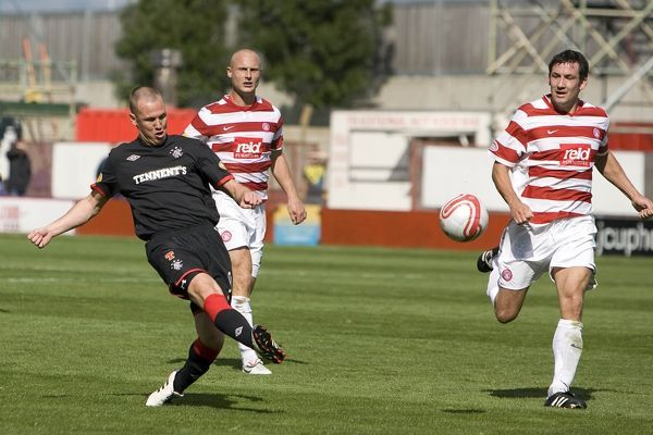 Rangers' Kenny Miller (black) scores the winning goal