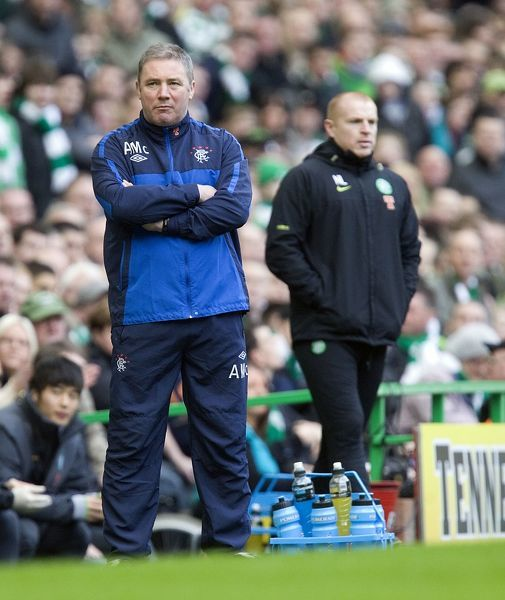 Rangers' assistant manager Ally McCoist (L) looks