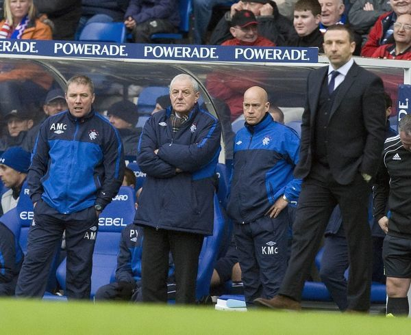 Rangers' (L-R) Ally McCoist, Walter Smith and Kenny McDowall watch