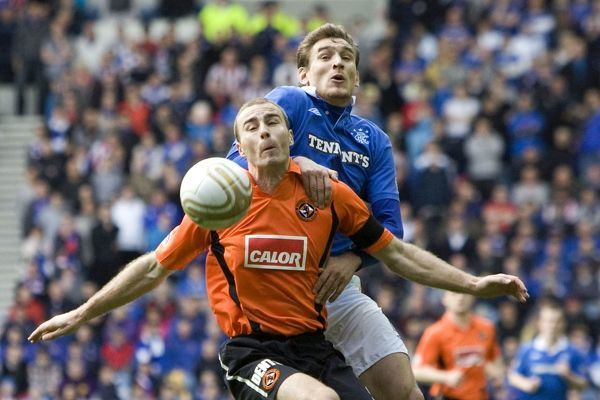 Rangers' Nikica Jelavic (R) and Dundee United's Paul Dixon (L)