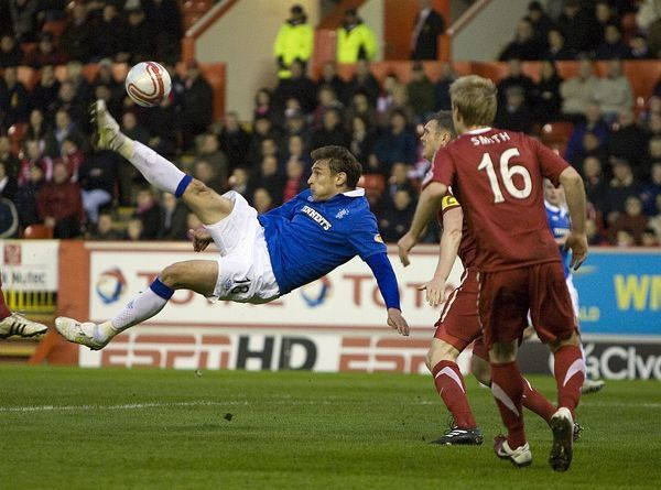 Rangers' Nikica Jelavic scores from an over head kick
