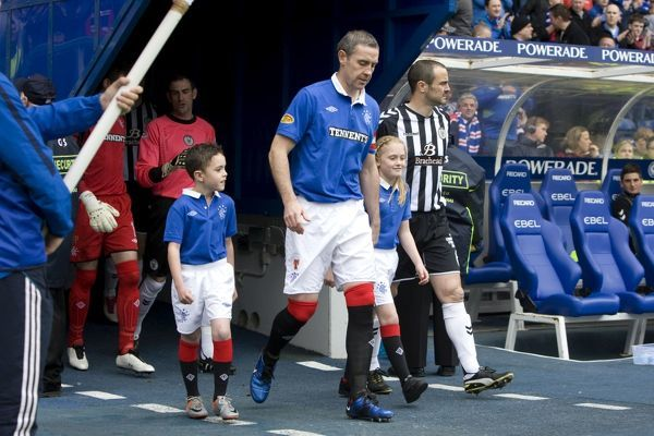 Rangers' captain David Weir and St Mirren's captain John Potter lead the mascots onto the pitch