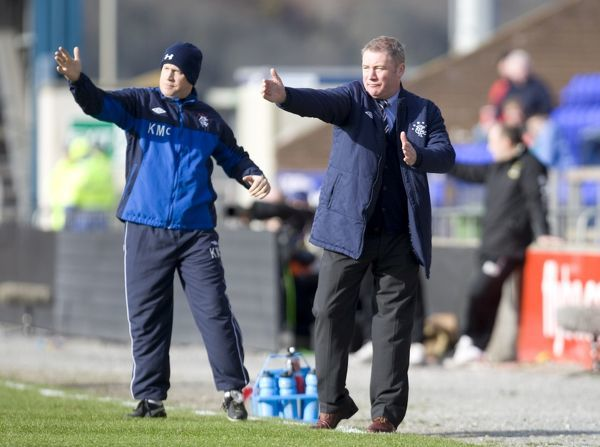 Rangers' manager Ally McCoist (R) urges on his players