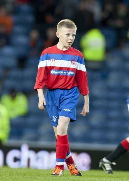 The Rangers U11 & 12's play on the pitch at half time