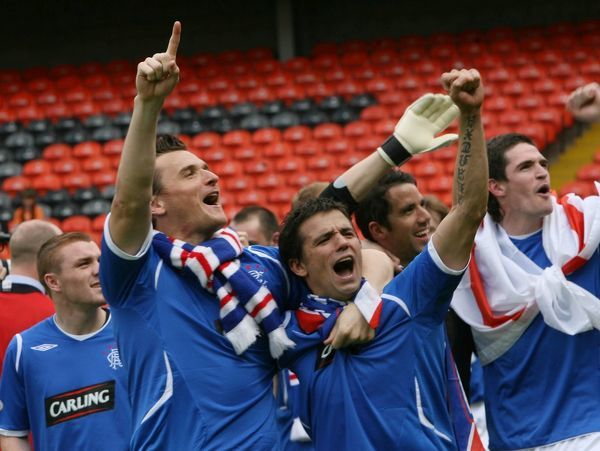 Rangers' Lee McCulloch and Nacho Novo celebrate winning the league
