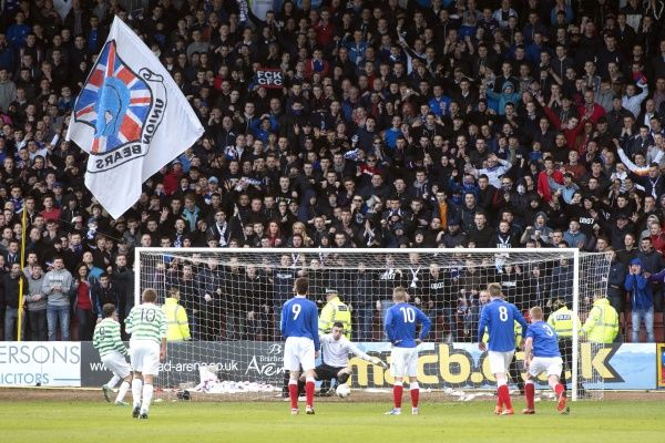 Rangers fans watch Celtic score from the penalty spot in the Glasgow Cup Final
