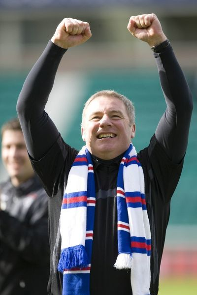 Rangers' Ally McCoist celebrates at the end of the match after they won the SPL title