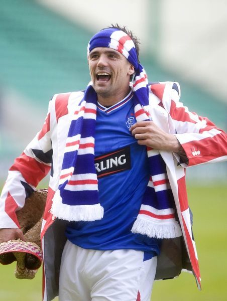 Rangers' Nacho Novo celebrates winning the league