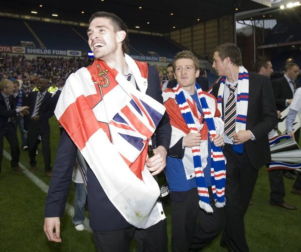 Rangers' Kyle Lafferty and Steven Davis celebrate winning the league
