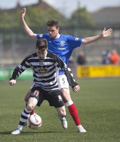 Rangers' Sebastien Faure and East Stirlingshire's Max Wright