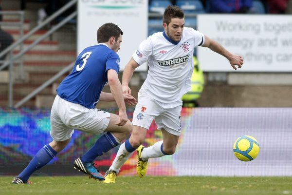Rangers' Andy Little and Peterhead's Stephen Noble
