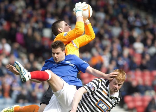 Rangers' Sebastien Faure tries to win the ball from Queens Park keeper Neil Parry