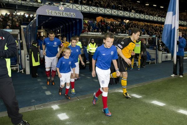 Rangers captain Lee McCulloch leads out the mascots