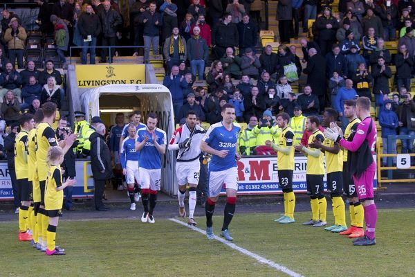 Rangers players run onto the pitch through a Livingston guard of honour during the Ladbrokes Championship match at the Tony Macaroni Arena, Livingston