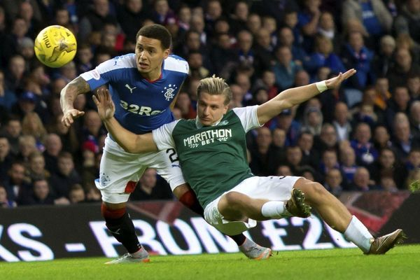 Rangers' James Tavernier and Hibernian's Jason Cummings during the Ladbrokes Championship match at Ibrox Stadium, Glasgow