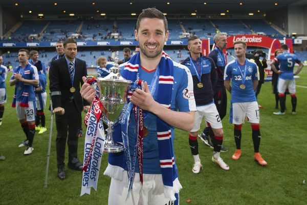Rangers' Nicky Clark celebrates with the Ladbrokes Championship Trophy at Ibrox Stadium, Glasgow