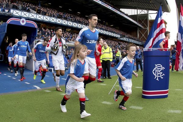 Rangers captain Lee Wallace and mascots during the Ladbrokes Championship match at Ibrox Stadium, Glasgow