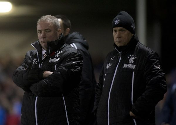 Rangers manager Ally McCoist (L) looks on alongside assistant manager Kenny McDowall