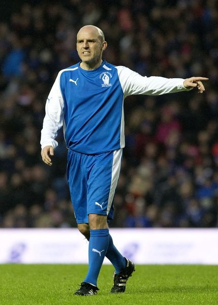 Alex Rae in action during the Fernando Ricksen Tribute match at Ibrox Stadium