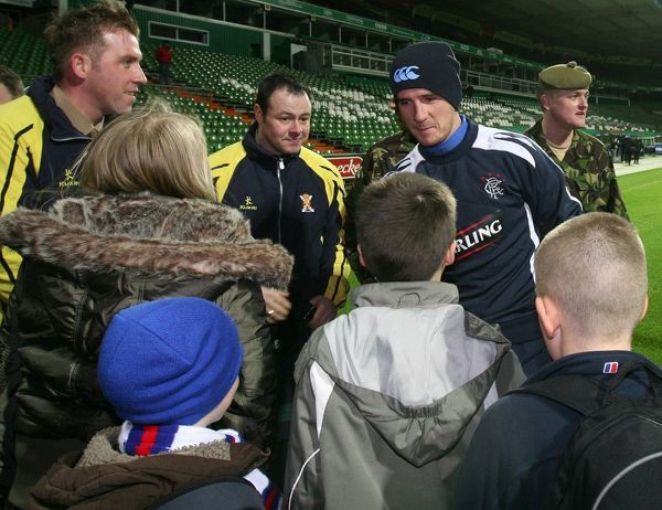 A group of Highlanders from the 4th Battalion of The Royal Regiment of Scotland meet Barry Ferguson and the Rangers team at Werder Bremen's stadium tonight