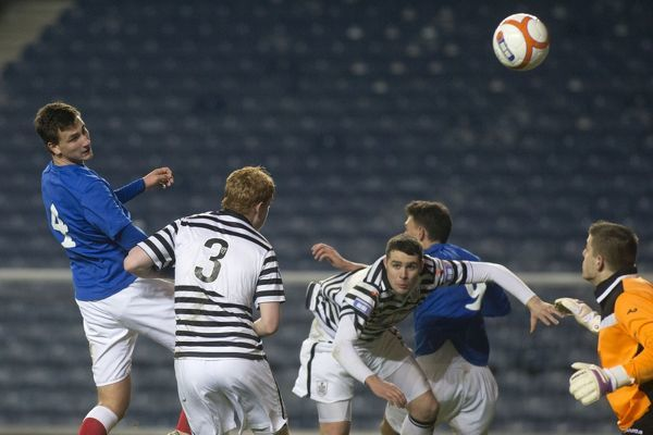 Rangers' Luca Gasparotto (4) heads home the second goal against Queens Park
