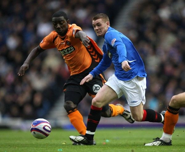 Rangers' John Fleck and Dundee United's Prince Buaben (left) battle for the ball
