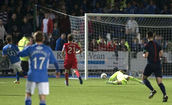 Queen of the South's Gavin Reilly scores the second goal during the Scottish Championship match at Palmerston Park