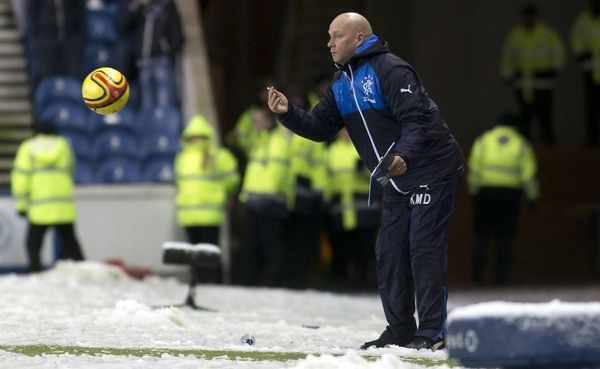 Rangers manager Kenny McDowall throws the match ball