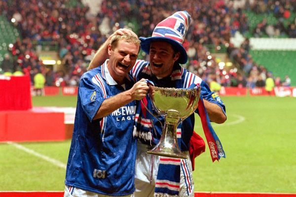 Rangers players Paul Gascoigne and Ally McCoist celebrate victory in the Scottish Coca Cola Cup