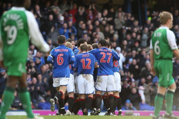 Rangers' Chris Burke is congratulated by his team mates after scoring the first goal