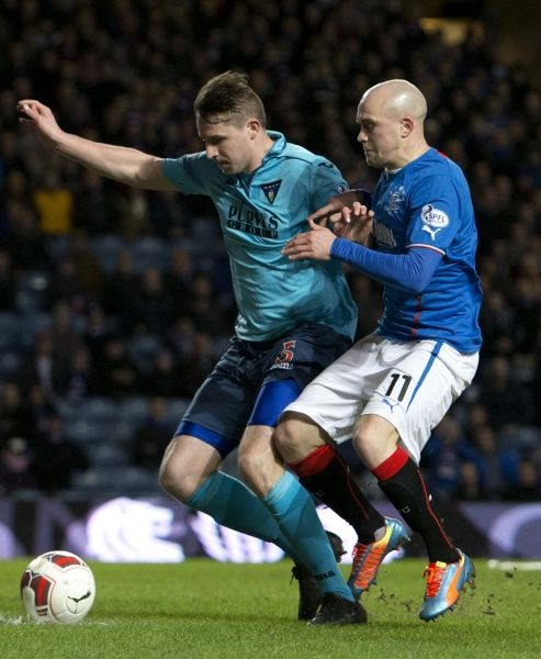 Rangers' Nicky Law and Dunfermline Athletic's Callum Morris (5) during the Scottish Cup match at Ibrox Stadium, Glasgow. PRESS ASSOCIATION Photo. Picture date: Friday February 7, 2014. See PA story SOCCER Rangers. Photo credit should read: PA Wire