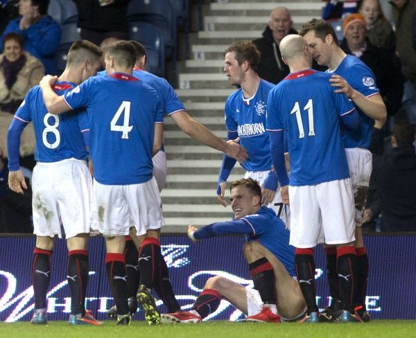 Rangers' Dean Shiels (ground) celebrates third goal with his team mates during the Scottish Cup match at Ibrox Stadium, Glasgow. PRESS ASSOCIATION Photo. Picture date: Friday February 7, 2014. See PA story SOCCER Rangers. Photo credit should read: PA Wire
