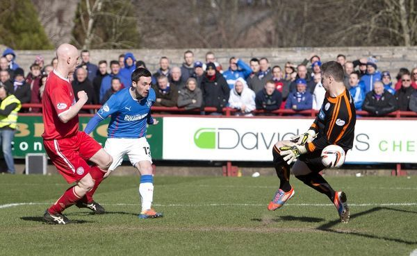 Rangers' Nicky Clark heads home the winning goal with his first touch of the ball