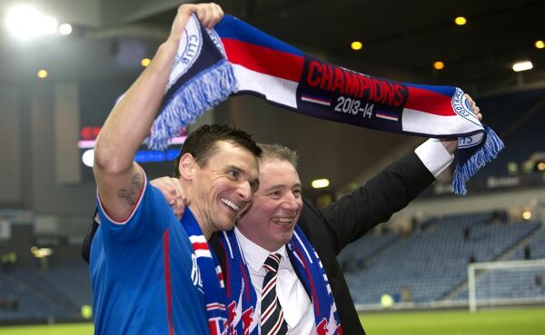 Rangers manager Ally McCoist celebrates winning the Scottish League One title with Club captain Lee McCulloch (left)