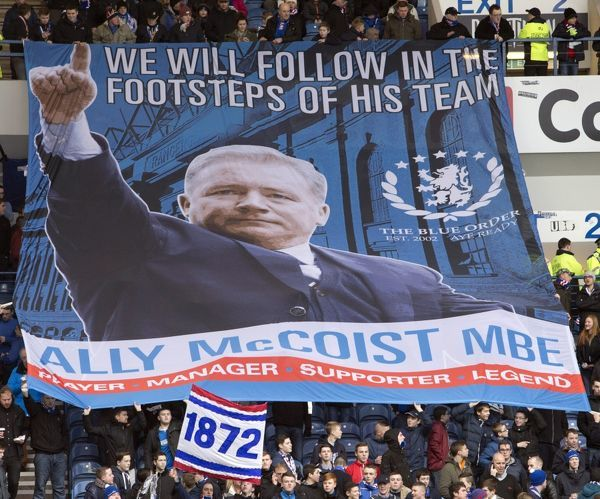 Rangers fans in the stands sow their support for manager Ally McCoist